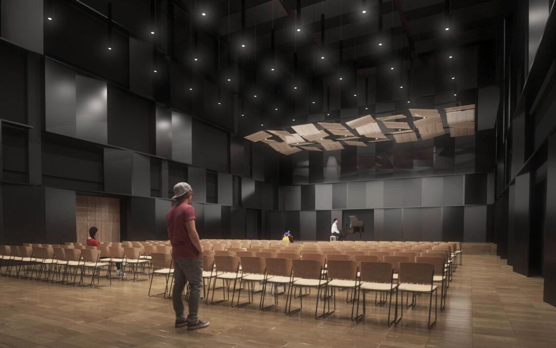 Havainnekuva Joensuun konservatorion uudesta konserttisalista mies seisoo lavalla